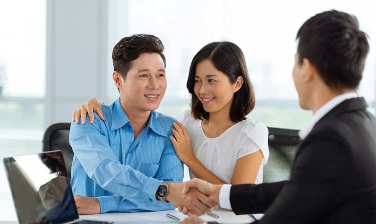 Asian couple renewing mortgage